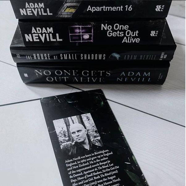 Stack of Adam Nevill books